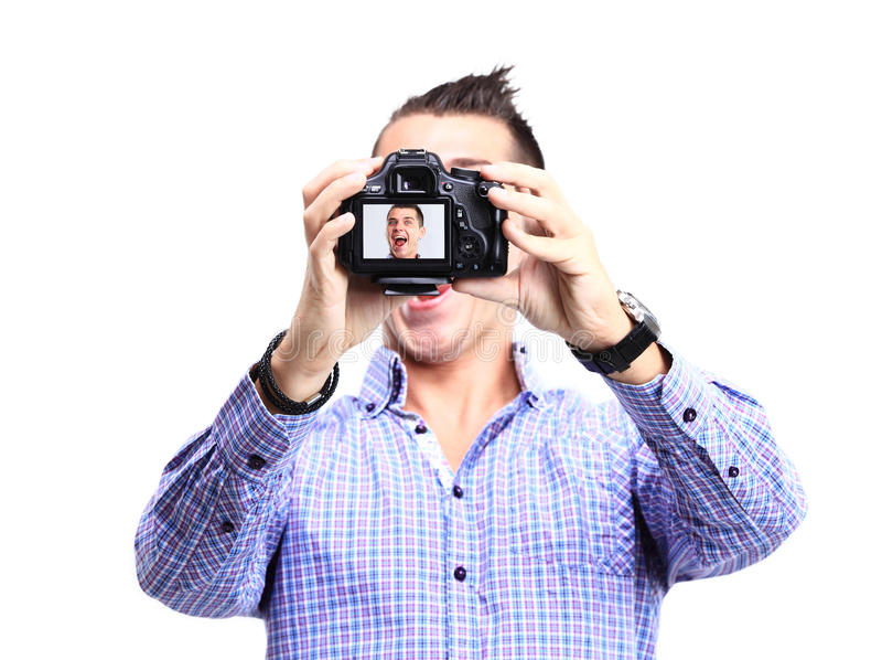 Happy young man taking a selfie photo stock images