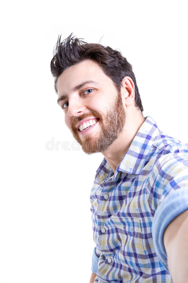 Happy young man taking a selfie photo isolated on white background stock photo