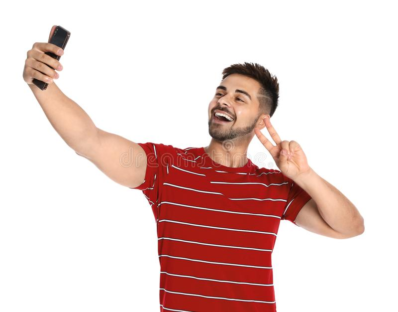 Happy young man taking selfie on white stock photo