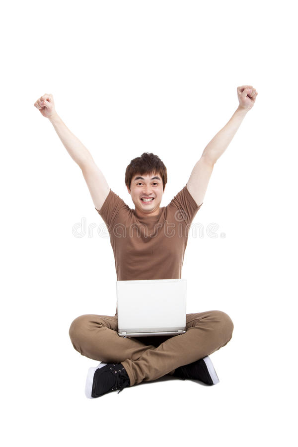 Download Happy Young Man Using Laptop Royalty Free Stock Photo - Image: 24491805