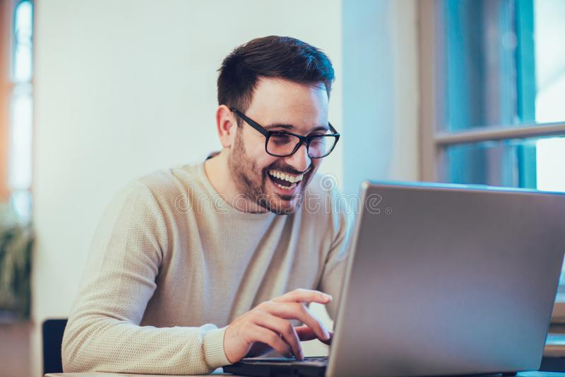 Happy young man, wearing glasses and smiling stock photo