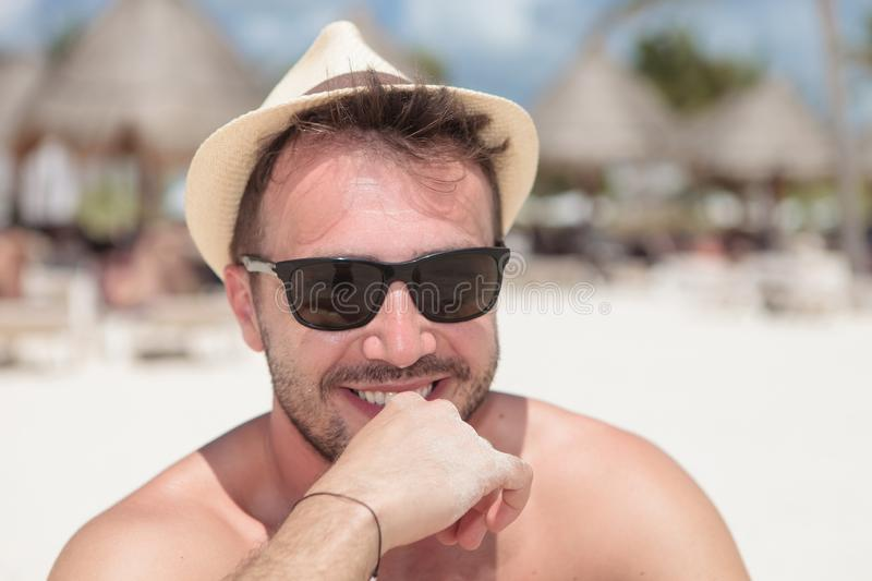 Happy young man wearing sunglasses and summer hat stock photo