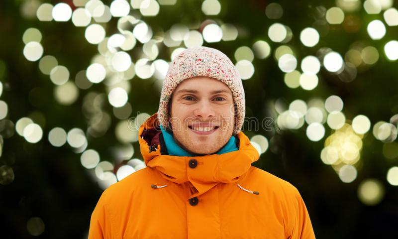 Happy young man in winter clothes outdoors stock photography