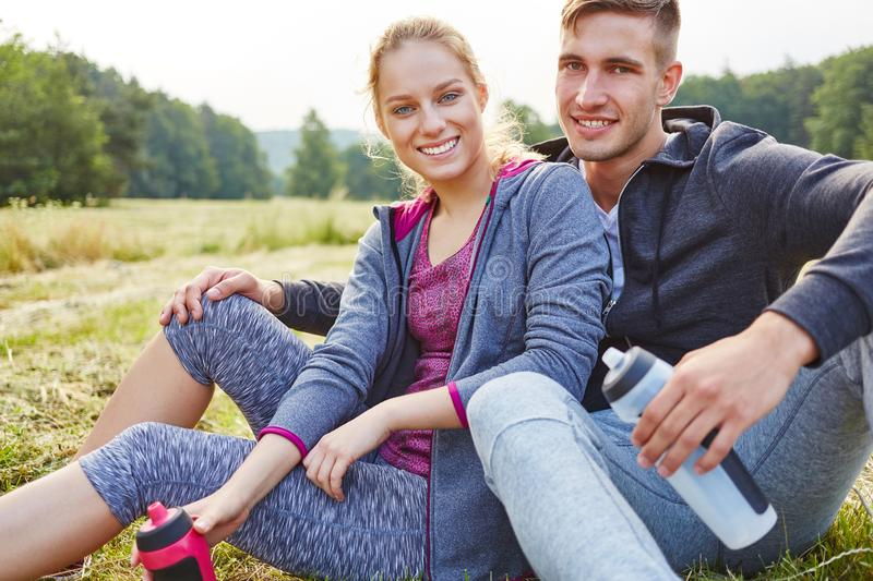 Young man and young woman as friends royalty free stock photo