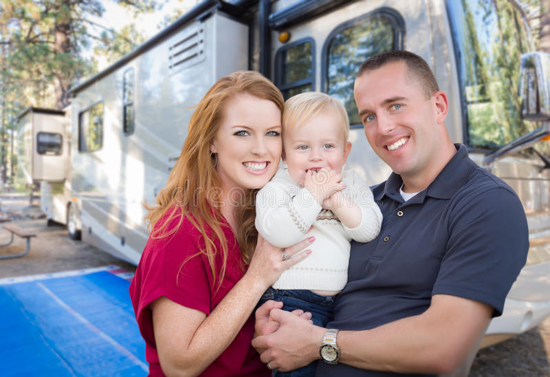 Happy Young Military Family In Front of Their Beautiful RV royalty free stock photography
