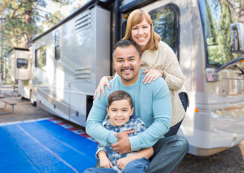 Happy Young Mixed Race Family In Front of Their Beautiful RV. At The Campground stock photography