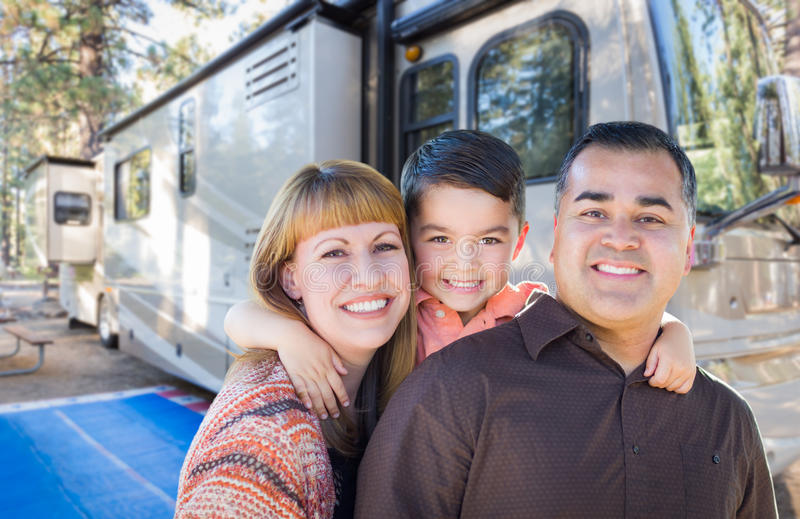 Happy Young Mixed Race Family In Front of Their Beautiful RV At. The Campground stock image