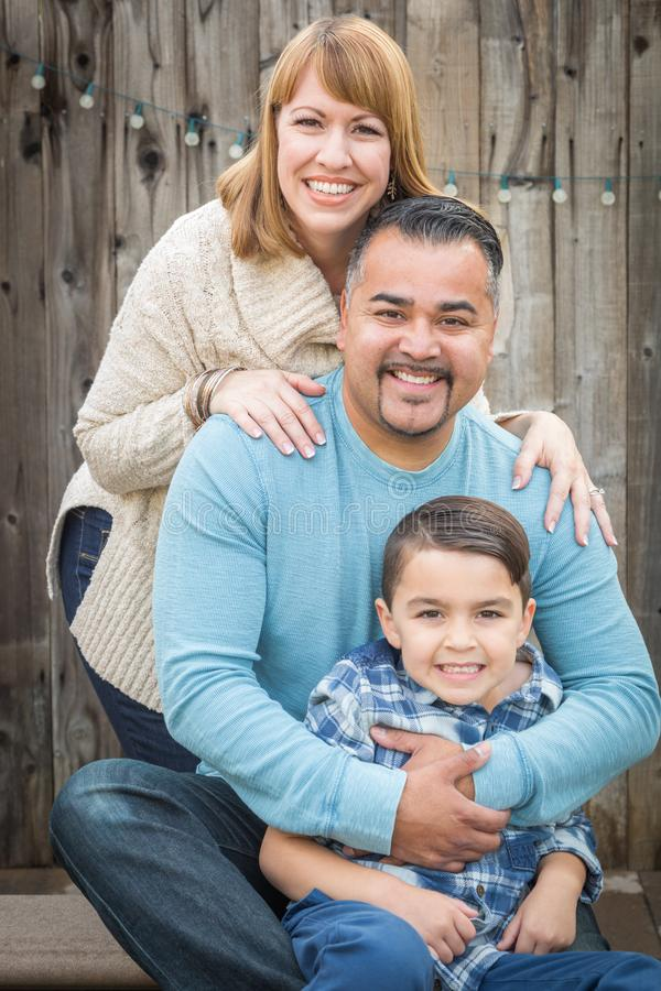 Happy Young Mixed Race Family Portrait Outside. Happy Young Mixed Race Family Portrait Ourside royalty free stock images