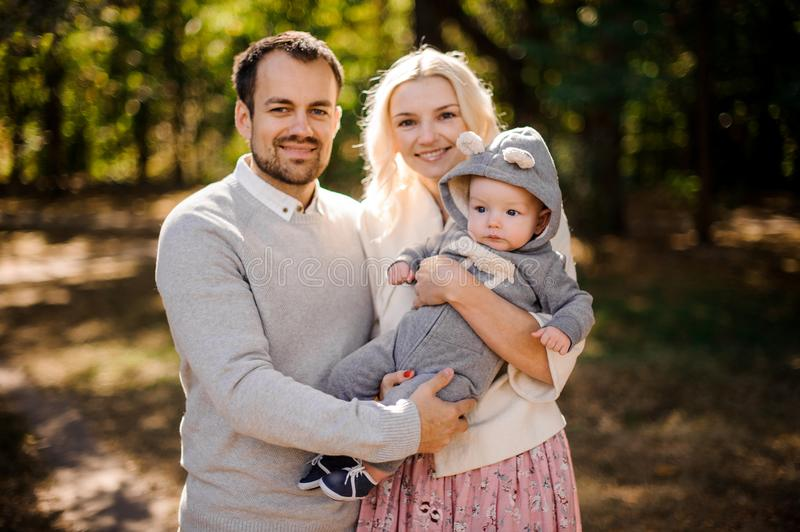 Happy young mother and father with a cute baby son royalty free stock photos