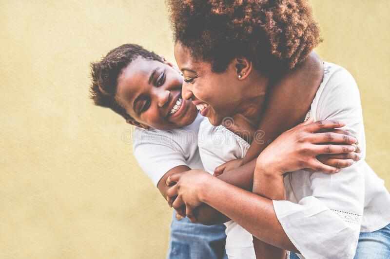 Happy young mother having fun with her kid - Son hugging his mum outdoor - Family connection, motherhood, love and tender moments stock images