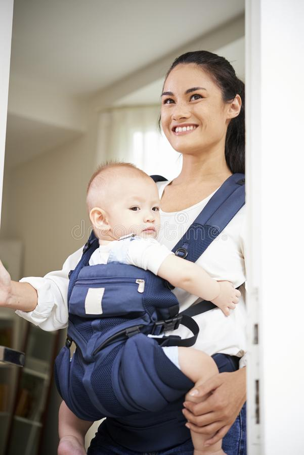 Young mother leaving house stock image