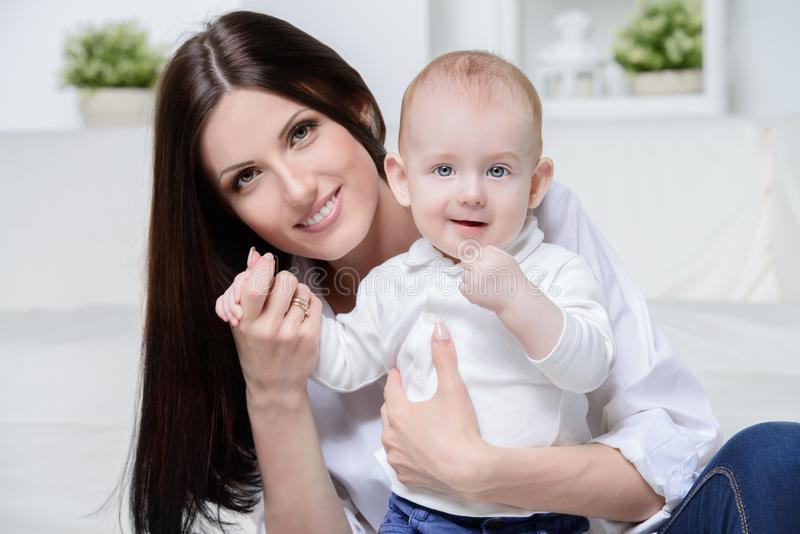 Happy young mom stock images