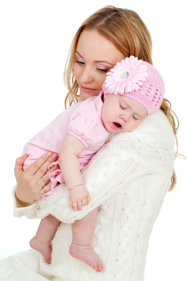 Happy young mother and sleeping baby. On her shoulder royalty free stock images