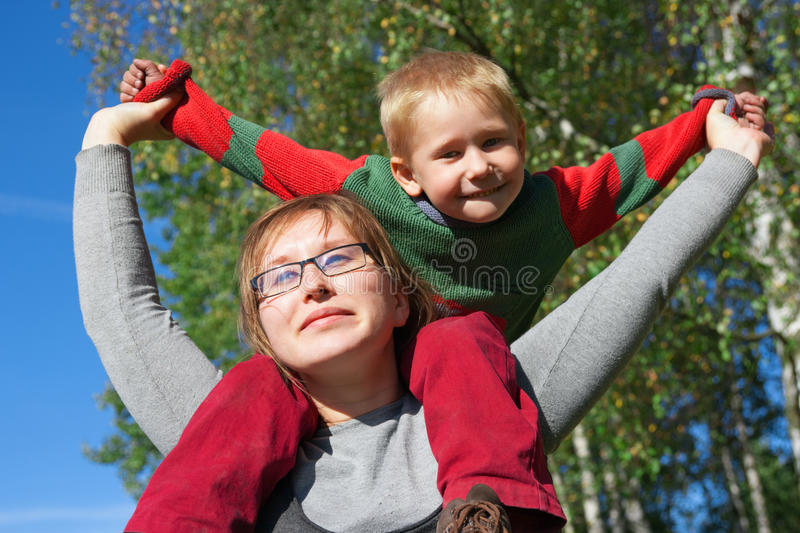 Happy young mother and son at beautiful day. stock photos