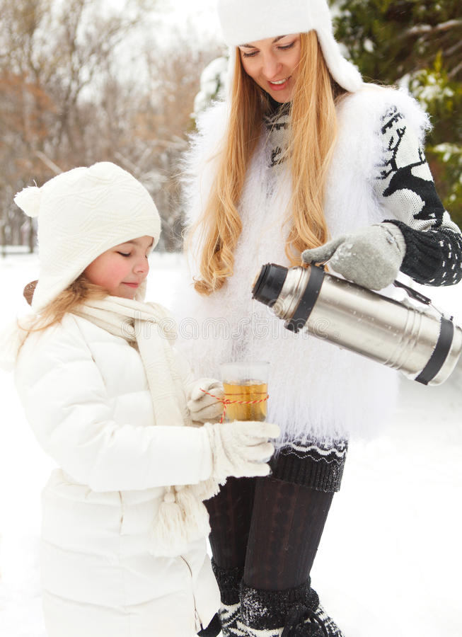 Free Happy Young Mother With Daughter On Winter Picnic Stock Image - 33887171