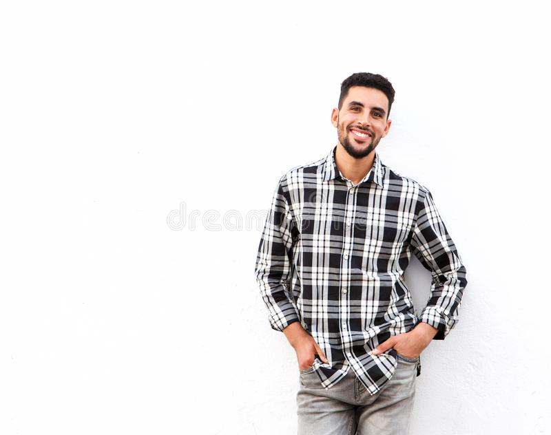 Happy young north african man smiling against white background stock photos
