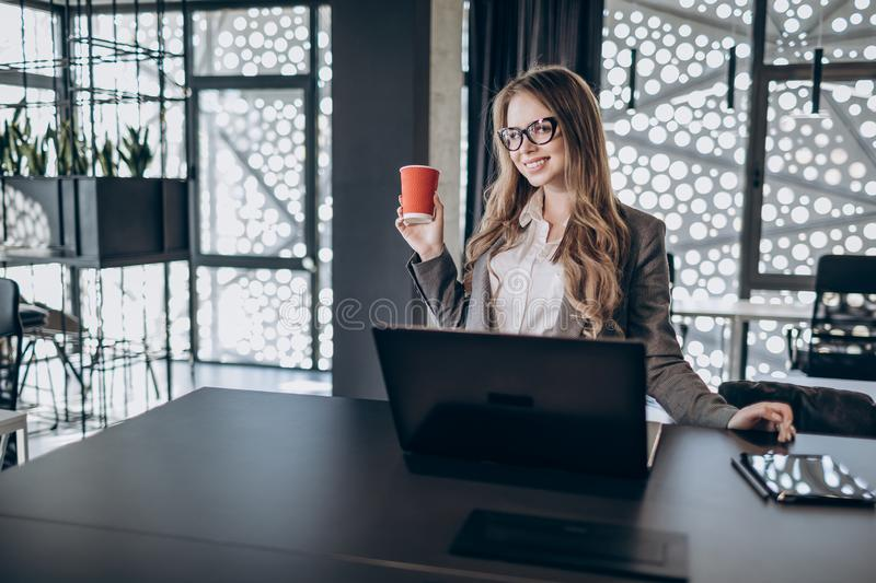 Happy Young Office Clerk Girl Enjoying Coffee royalty free stock image