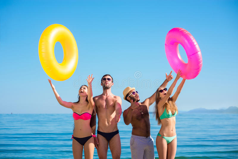Happy young people on the beach. stock photography