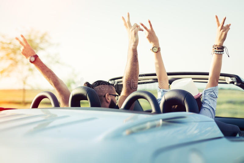 Happy young people in convertible car stock image