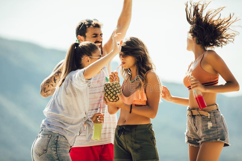 Young people dancing at the beach and having fun stock photo
