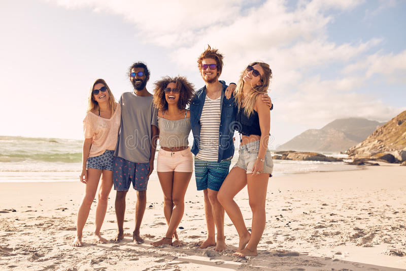 Happy young people enjoying a day at beach royalty free stock photography