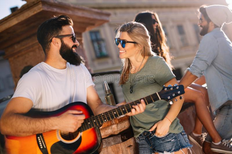 Happy young people having fun spending good time together royalty free stock photos