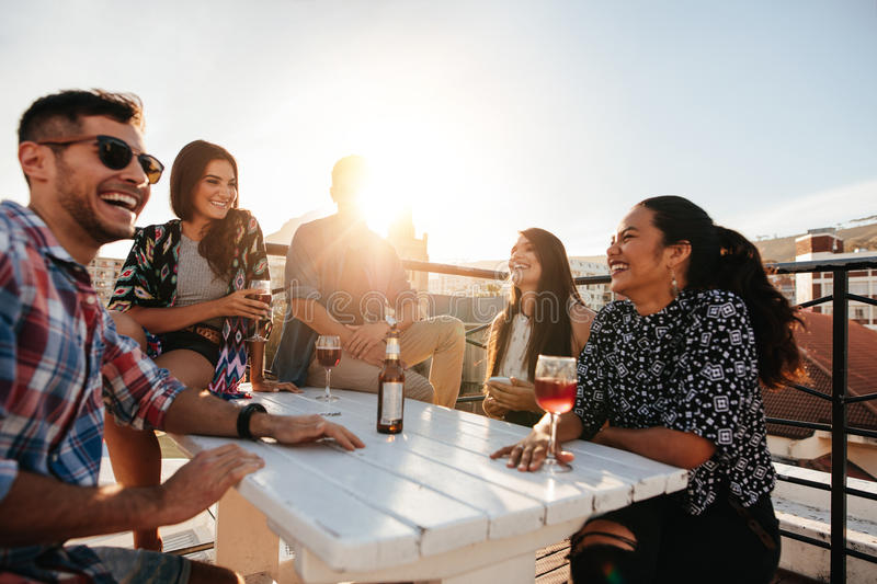 Happy young people having a rooftop party stock photography