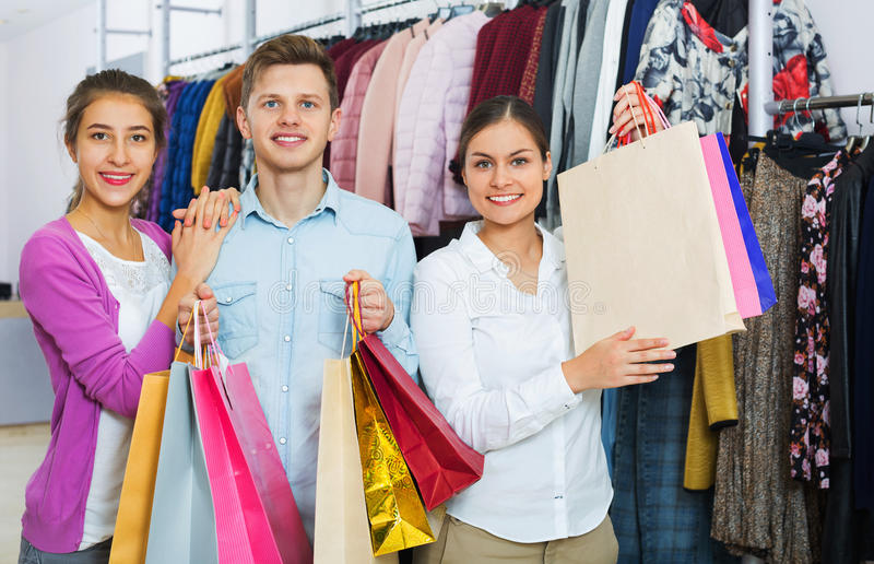 Happy young people with purchases stock images