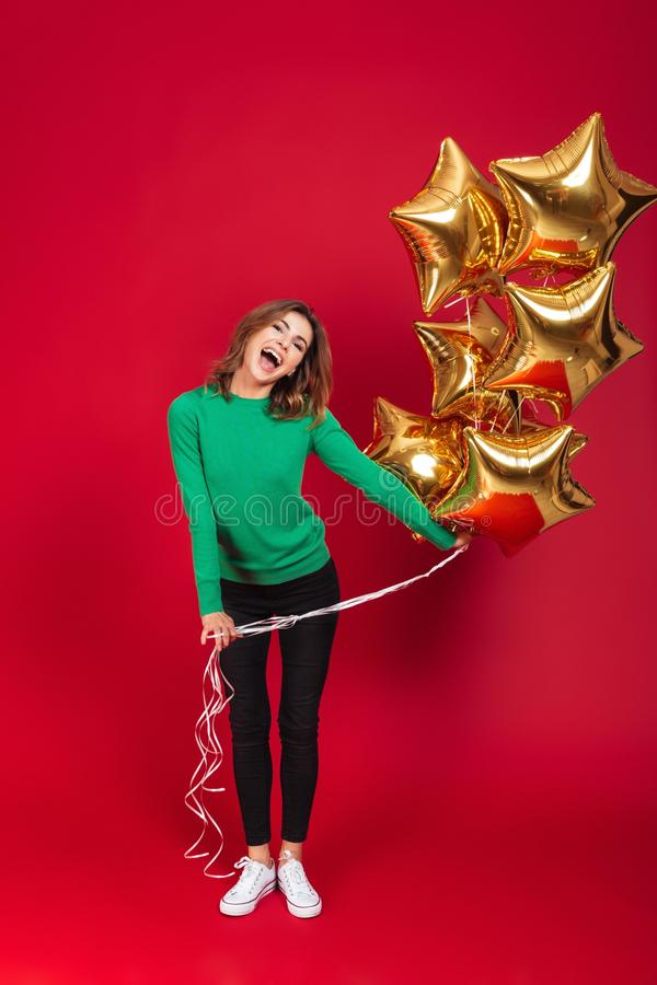 Happy young pretty woman holding balloons. stock photo