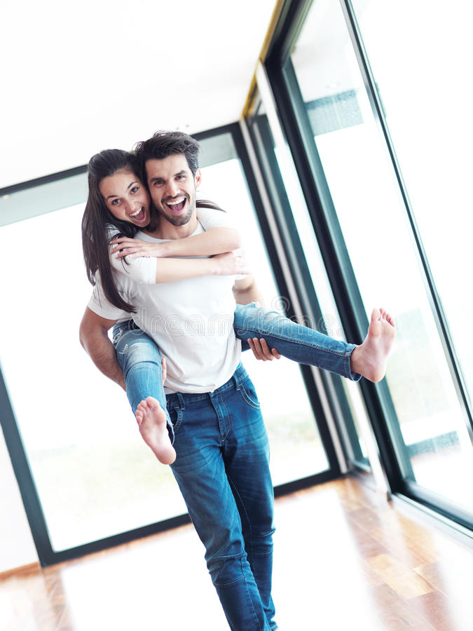 Happy young romantic couple have fun and relax at home indoors stock photos