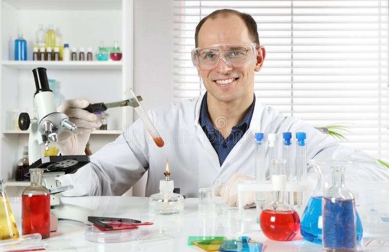 Happy young scientist conducting research in a chemical laboratory stock photography
