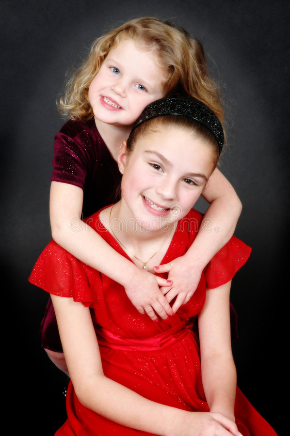 Happy young sisters royalty free stock image