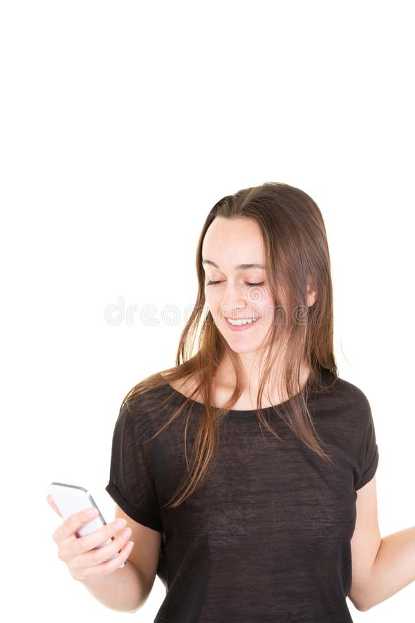 Happy young smiling woman using texting mobile phone against white background royalty free stock photo