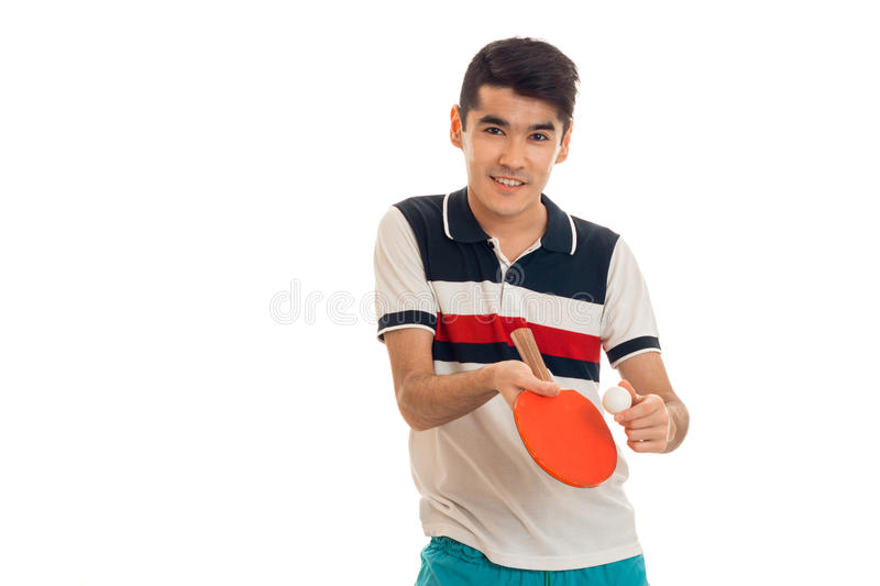 Happy young sports man playing ping-pong isolated on white background royalty free stock image