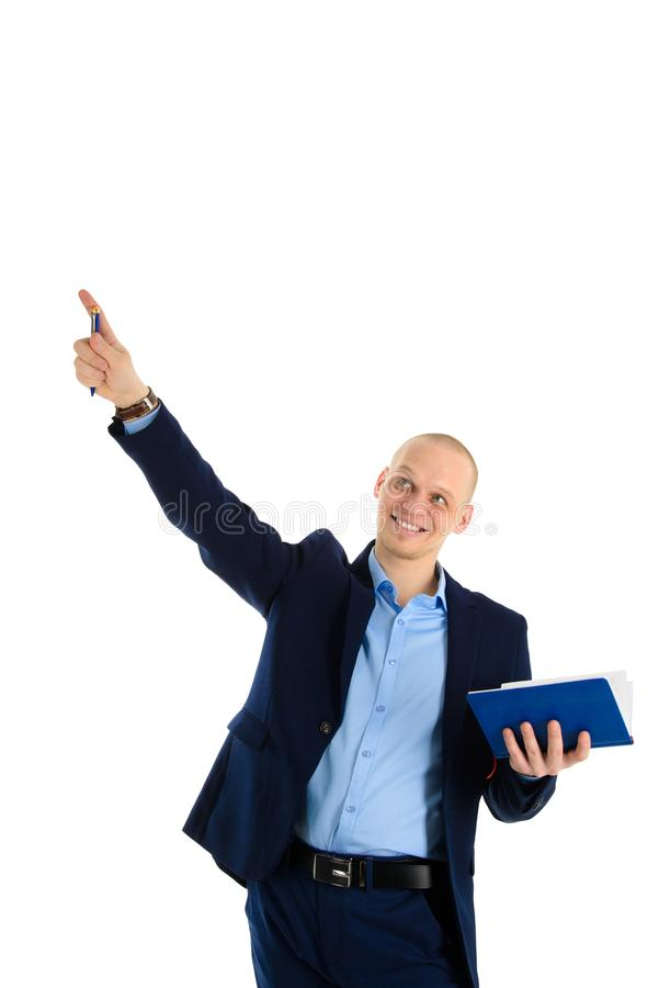Happy young successful caucasian man suit holding a pen and notebook have new idea. Education or business theme. stock image