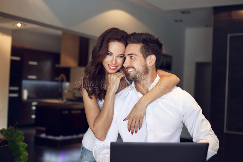 Happy young successful manager couple at home stock photos