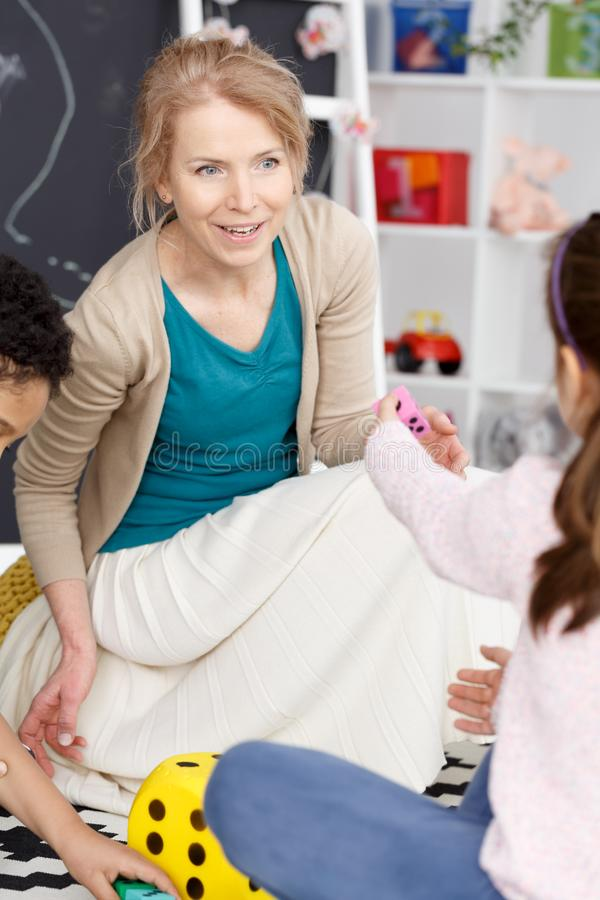 Happy young teacher royalty free stock image