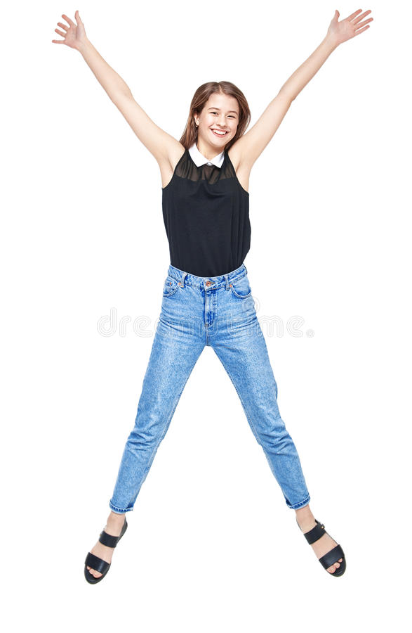 Happy young teenager girl jumping isolated. On white background royalty free stock images