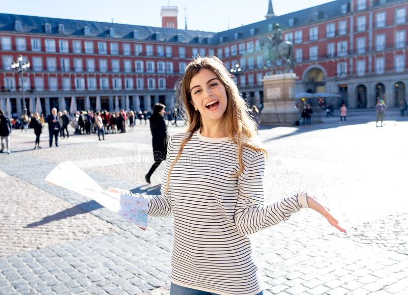 Happy young tourist woman with map searching new places in Spain. In tourism around Europe concept stock photography