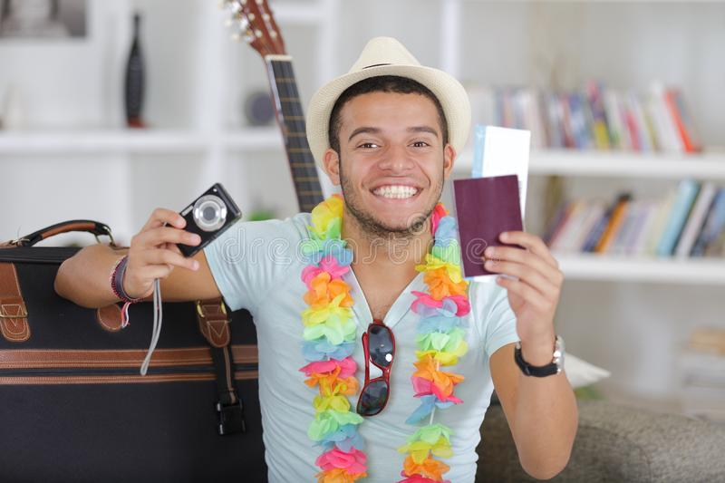 Happy young vietnamese man with digital camera and passport stock images