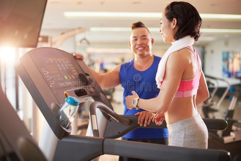 Working out with fitness trainer stock images