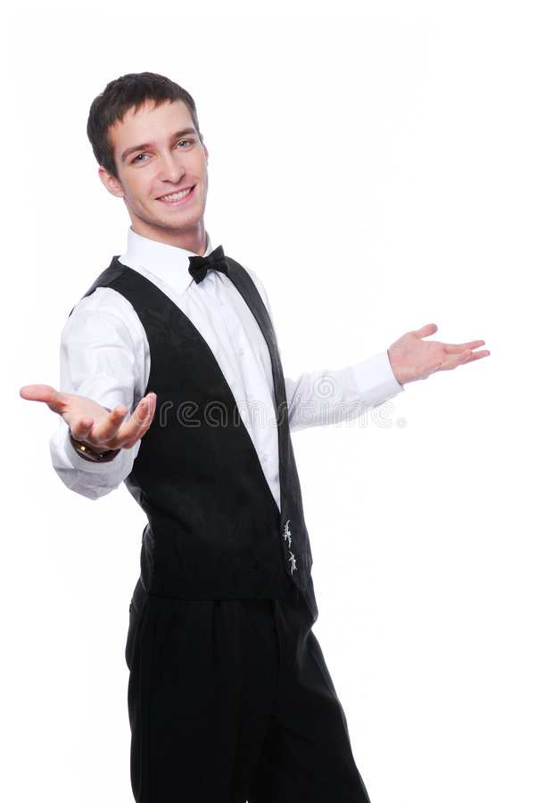 Happy young waiter stock images