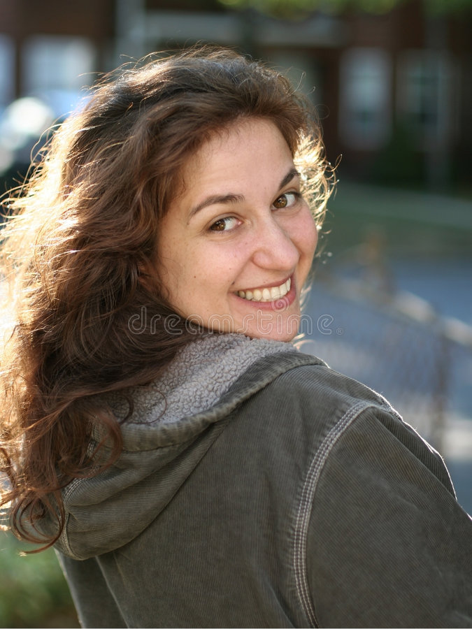 Happy young woman. Outdoors royalty free stock photo