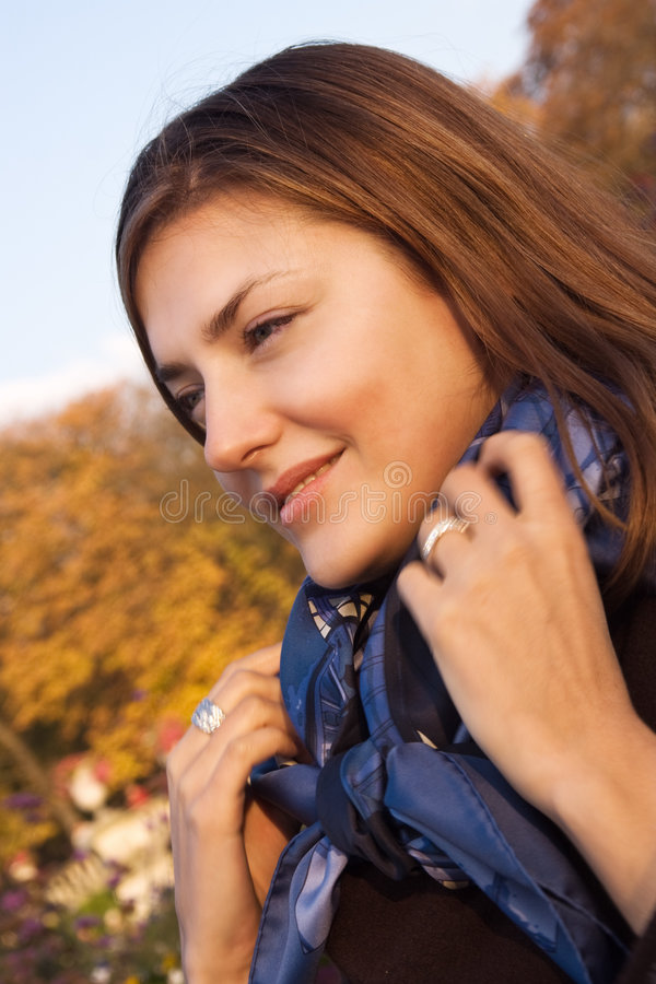 Happy young woman in an autumn park royalty free stock image
