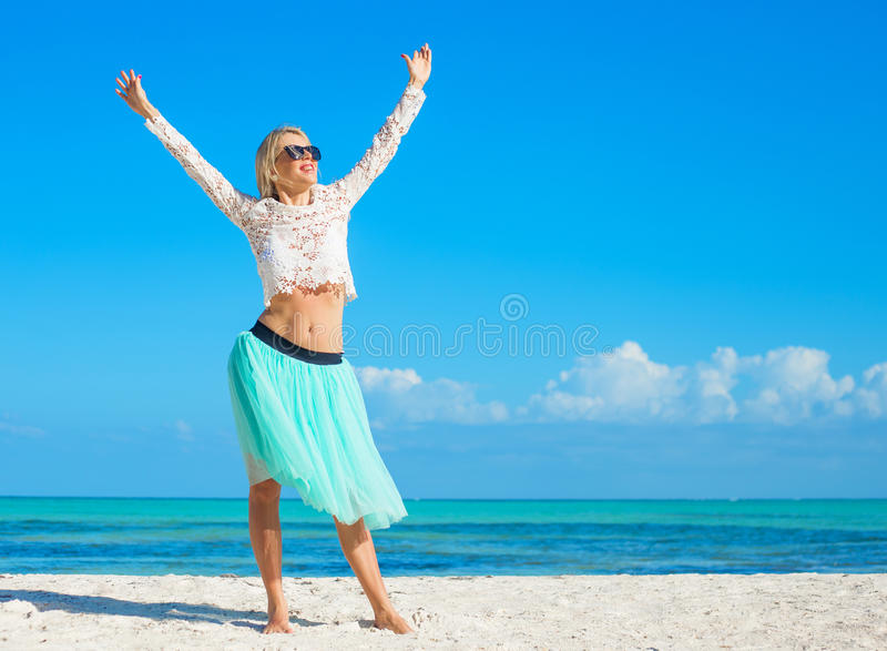 Happy young woman on the beach royalty free stock image