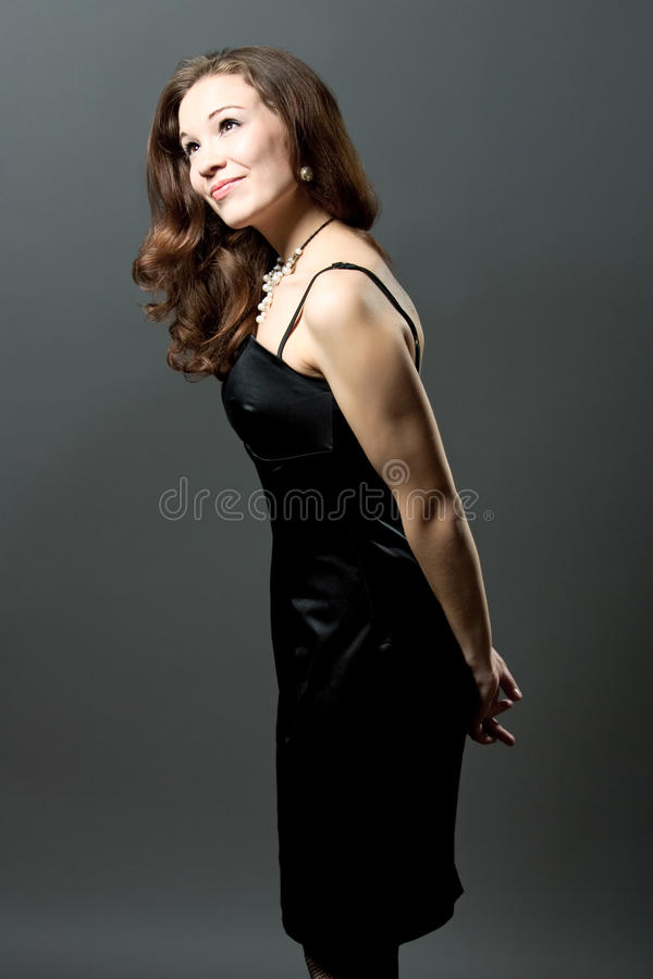 Happy Young Woman In Black Evening Dress Royalty Free Stock Photo