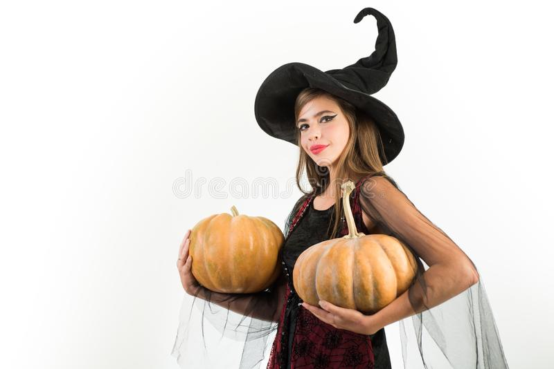 Happy young women in black witch halloween costumes on party over white background. Cheerful woman with pumpkin over stock images