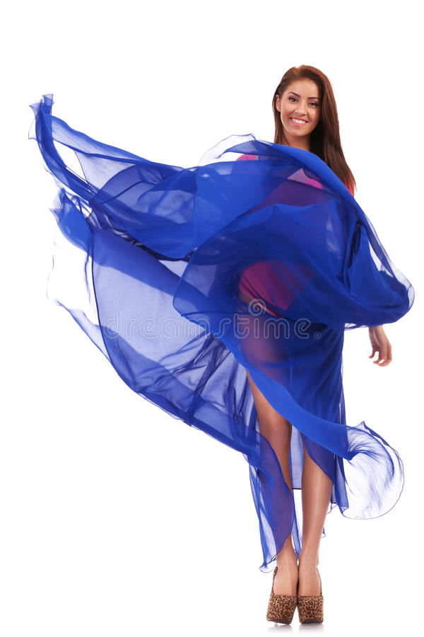 Download Happy Young Woman In Blue Long Wavy Dress Stock Image - Image: 25949643