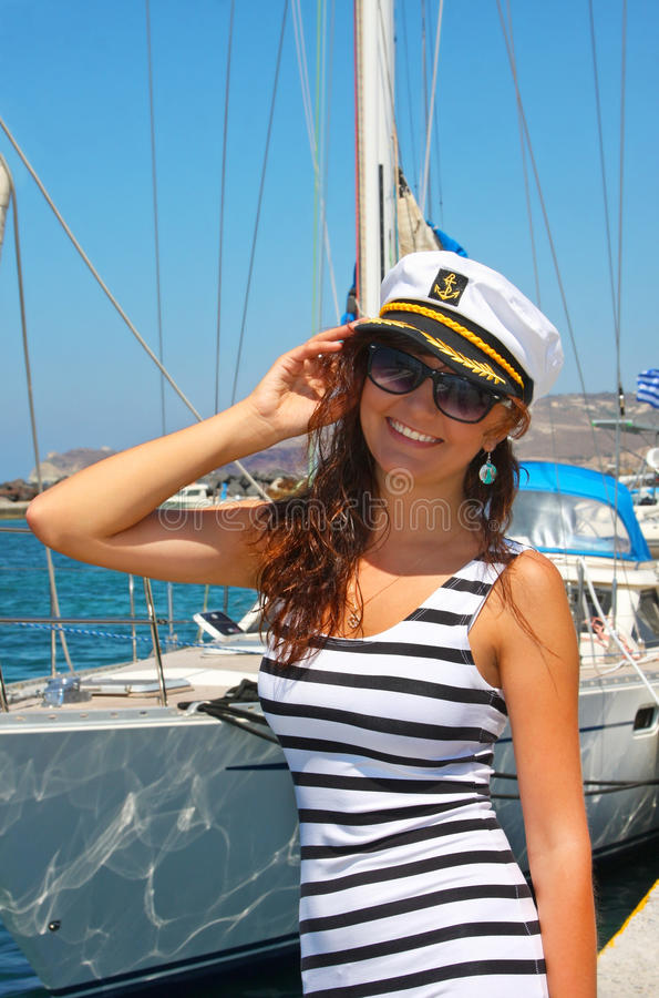Happy young woman in cap captain stock photos