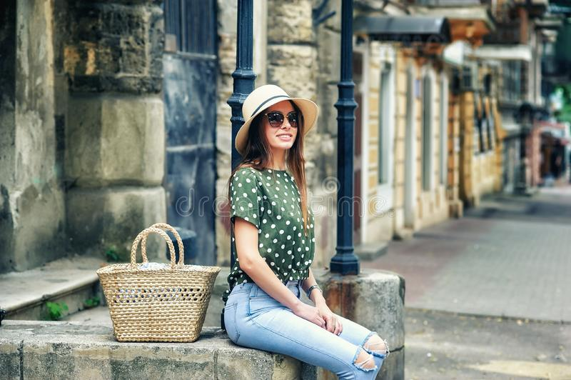 Happy young woman in casual wear on a street of a European city royalty free stock photo